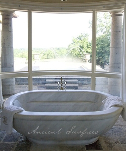An Oval Hand Carved Marble Tub