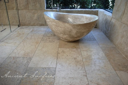 Hand Carved Oval Limestone Bath Tub with a Waved Edge