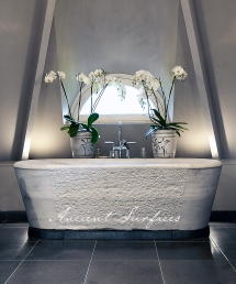 A Distressed Antique Marble Bath Tub